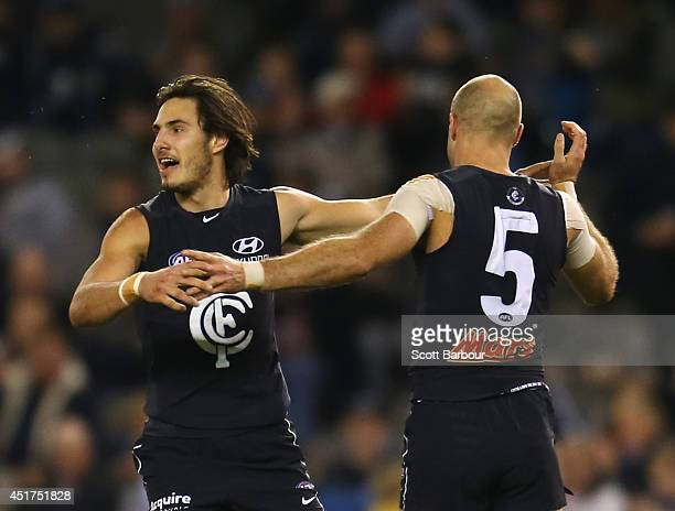 Troy Menzel celebrates with Chris Judd of the Blues after kicking a goal during the round 16 AFL match between the Carlton Blues and the St Kilda...