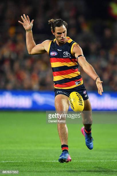 Troy Menzel of the Crows kicks the ball during the round eight AFL match between the Adelaide Crows and the Melbourne Demons at Adelaide Oval on May...