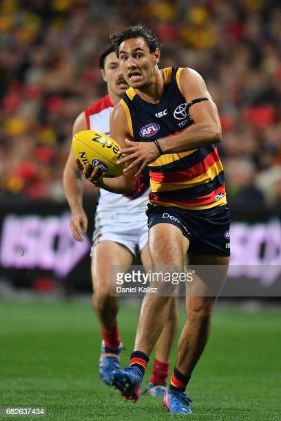 Troy Menzel of the Crows looks to pass the ball during the round eight AFL match between the Adelaide Crows and the Melbourne Demons at Adelaide Oval...