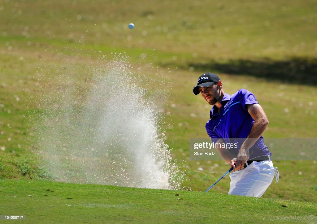Troy Merritt hits from a bunker on the sixth hole during the final round of the Chitimacha Louisiana Open at Le Triomphe Country Club on March 24, 2013 in Broussard, Louisiana.
