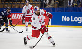 Troy Milam of Red Bull Salzburg takes a snapshot on goal during the Champions Hockey League group stage game between HV71 Jonkoping and Red Bull...