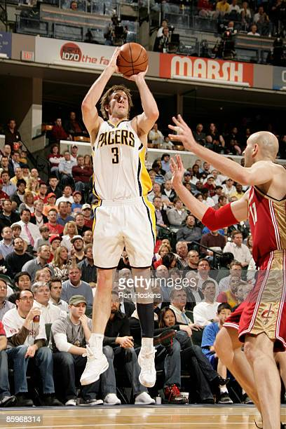 Troy Murphy of the Indiana Pacers shoots over Zydrunas Ilgauskas of the Cleveland Cavaliers at Conseco Fieldhouse on April 13 2009 in Indianapolis...