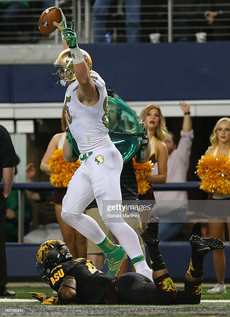 Troy Niklas #85 of the Notre Dame Fighting Irish celebrates a touchdown against Alden Darby #4 of the Arizona State Sun Devils at Cowboys Stadium on October 5, 2013 in Arlington, Texas.
