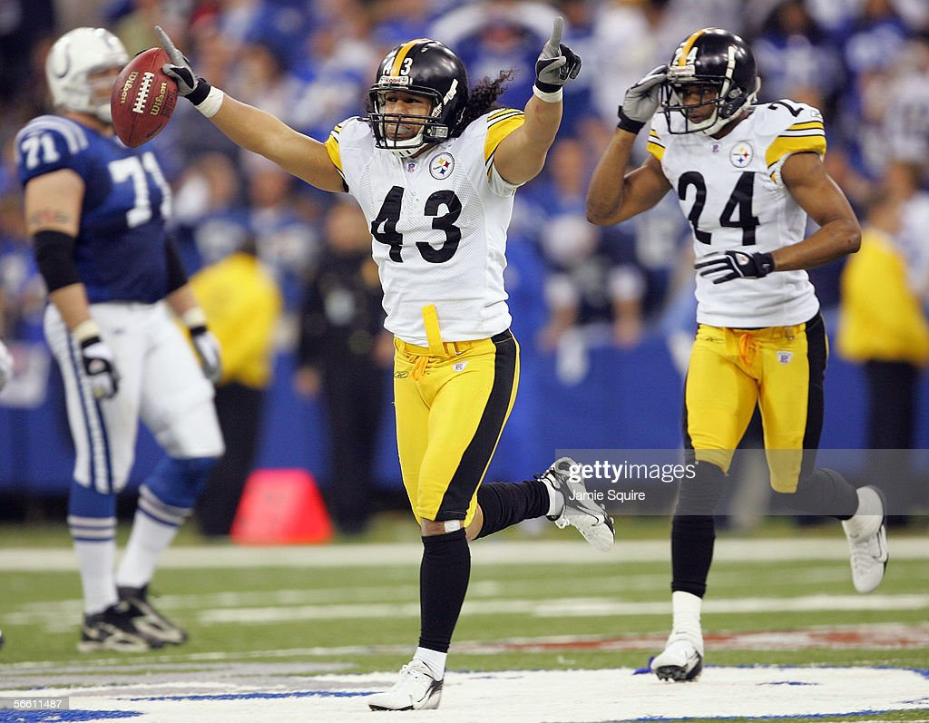 Troy Polamalu of the Pittsburgh Steelers runs ahead of teammate Ike Taylor as he celebrates an interception the interception was overturned when the...