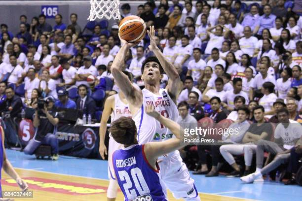 Troy Rosario of the Philippines tries to get a shot off his defender Naratip Boonserm of Thailand Philippines drubs Thailand 10853 during their match...