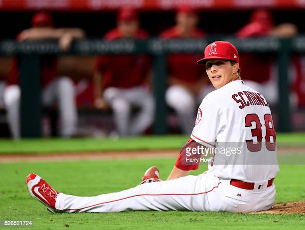 Troy Scribner of the Los Angeles Angels reacts after he slips and falls off the mound on a pitch during the fifth inning against the Oakland...