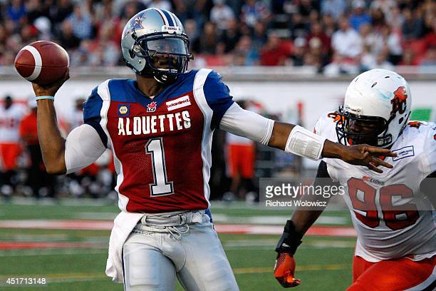 Troy Smith of the Montreal Alouettes passes the ball in front of Khalif Mitchell of the BC Lions during the CFL game at Percival Molson Stadium on...