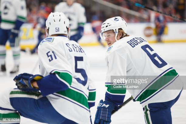 Troy Stecher and Brock Boeser of the Vancouver Canucks warm up before playing against the Edmonton Oilers on April 9 2017 at Rogers Place in Edmonton...