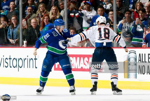 Troy Stecher of the Vancouver Canucks and Ryan Strome of the Edmonton Oilers drop their gloves as they fight during their NHL game at Rogers Arena...