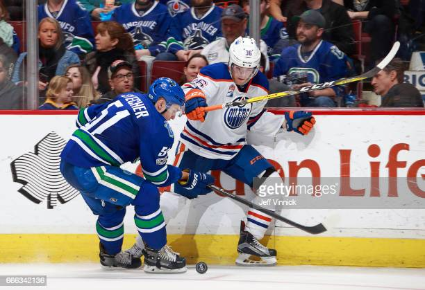 Troy Stecher of the Vancouver Canucks checks Drake Caggiula of the Edmonton Oilers during their NHL game at Rogers Arena April 8 2017 in Vancouver...