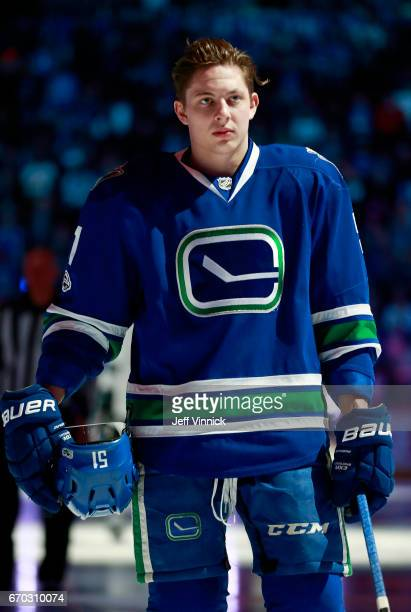 Troy Stecher of the Vancouver Canucks listens to the national anthem during their NHL game against the San Jose Sharks at Rogers Arena April 2 2017...