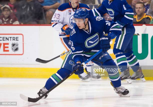 Troy Stecher of the Vancouver Canucks makes a pass in NHL action against the Edmonton Oilers on April 8 2017 at Rogers Arena in Vancouver British...