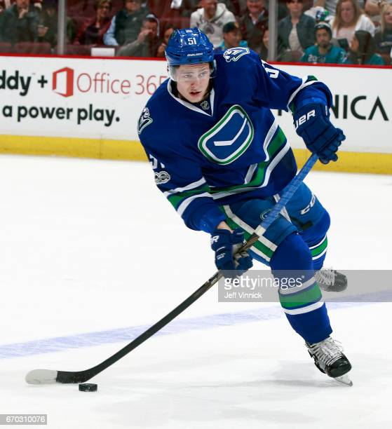 Troy Stecher of the Vancouver Canucks passes the puck up ice during their NHL game against the San Jose Sharks at Rogers Arena April 2 2017 in...