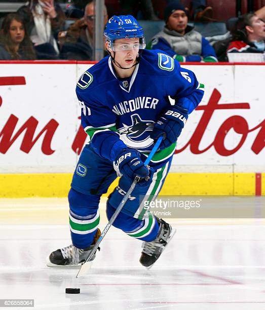 Troy Stecher of the Vancouver Canucks skates up ice with the puck during their NHL game against the New York Rangers at Rogers Arena November 15 2016...