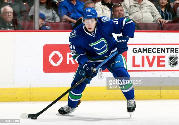 Troy Stecher of the Vancouver Canucks skates up ice with the puck during their NHL game against the San Jose Sharks at Rogers Arena April 2 2017 in...