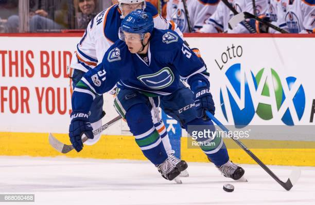 Troy Stecher of the Vancouver Canucks skates with the puck in NHL action against the Edmonton Oilers on April 8 2017 at Rogers Arena in Vancouver...