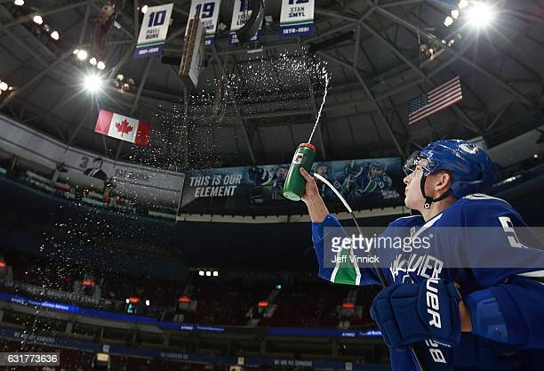 Troy Stecher of the Vancouver Canucks sprays water before their NHL game against the New Jersey Devils at Rogers Arena January 15 2017 in Vancouver...