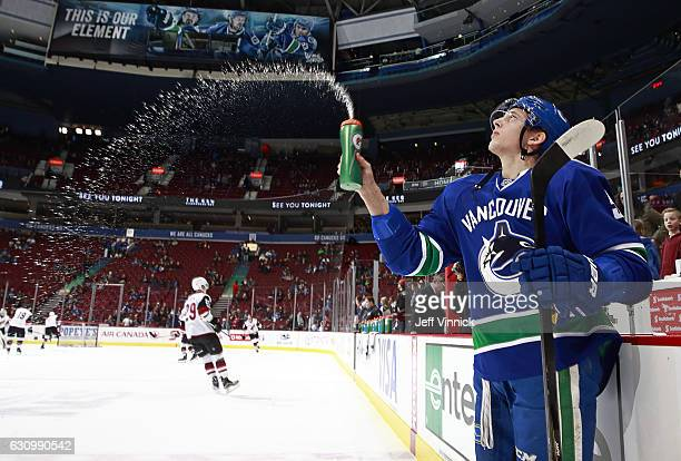Troy Stecher of the Vancouver Canucks sprays water on the ice before his NHL game against the the Arizona Coyotes at Rogers Arena January 4 2017 in...