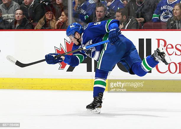 Troy Stecher of the Vancouver Canucks takes a shot during their NHL game against the Tampa Bay Lightning at Rogers Arena December 16 2016 in...