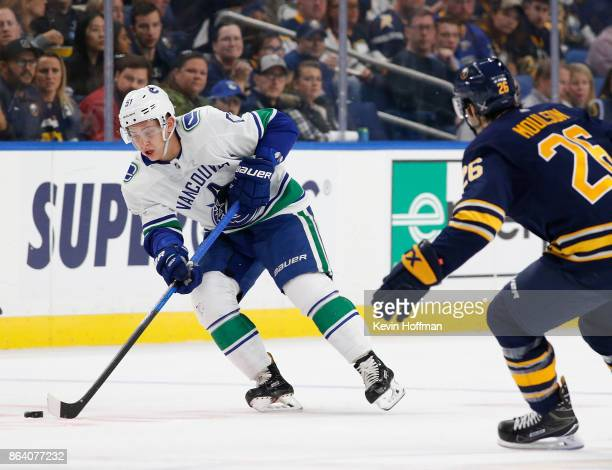 Troy Stecher of the Vancouver Canucks with th epic as Matt Moulson of the Buffalo Sabres defends during the first period at the KeyBank Center on...