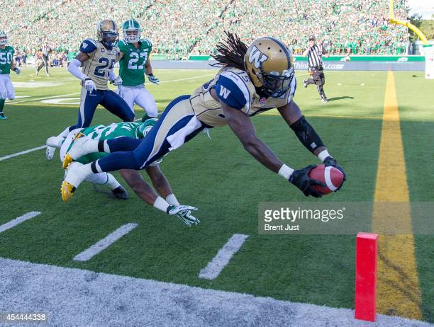 Troy Stoudermire of the Winnipeg Blue Bombers dives for a touchdown during a kick return in a game between the Winnipeg Blue Bombers and Saskatchewan...