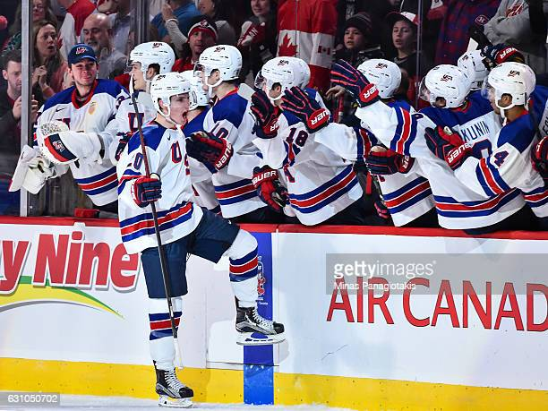 Troy Terry of Team United States celebrates with teammates on the bench after scoring a goal in the shootout during the 2017 IIHF World Junior...