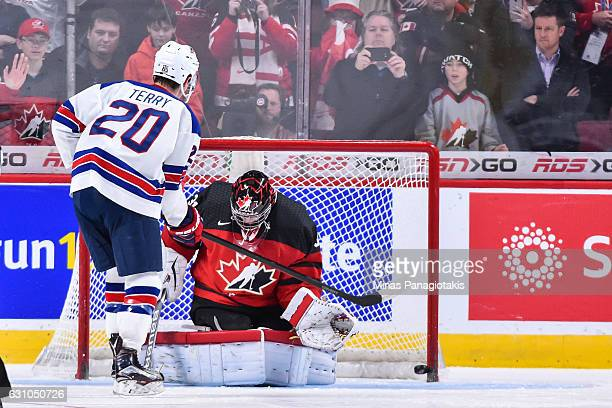 Troy Terry of Team United States scores on goaltender Carter Hart of Team Canada in a shootout during the 2017 IIHF World Junior Championship gold...