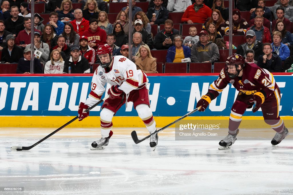 Troy Terry #19 of the Denver Pioneers controls the puck against Carson Soucy #21 of the Minnesota-Duluth Bulldogs in the third period during the 2017 NCAA Div I Men's Ice Hockey Championships at the United Center on April 8, 2017 in Chicago, Illinois.