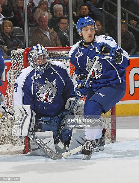 Troy Timpano and Cole Mayo of the Sudbury Wolves watch for an incoming shot against the London Knights during an OHL game at Budweiser Gardens on...