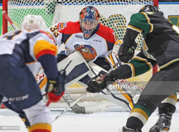 Troy Timpano of the Erie Otters gets set to stop a scoring attempt against the London Knights during an OHL game at Budweiser Gardens on March 10...