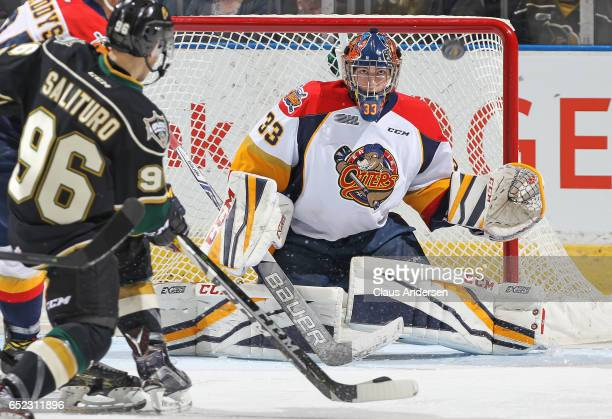 Troy Timpano of the Erie Otters keeps his eyes on an incoming shot by Dante Salituro of the London Knights during an OHL game at Budweiser Gardens on...