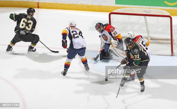 Troy Timpano of the Erie Otters makes a stop on Cliff Pu of the London Knights during an OHL game at Budweiser Gardens on March 10 2017 in London...