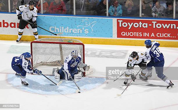 Troy Timpano of the Sudbury Wolves stops a shot from JJ Piccinich of the London Knights during an OHL game at Budweiser Gardens on October 9 2015 in...
