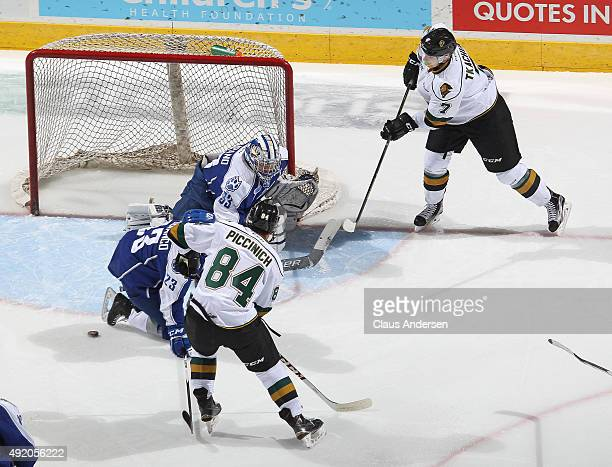 Troy Timpano of the Sudbury Wolves stops an attempt by Matthew Tkachuk of the London Knights during an OHL game at Budweiser Gardens on October 9...