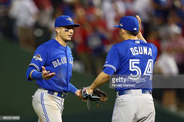 Troy Tulowitzki and Roberto Osuna of the Toronto Blue Jays celebrate after defeating the Texas Rangers in game three of the American League Division...