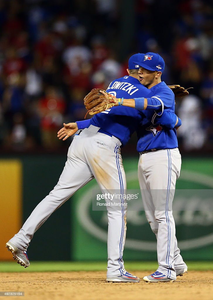 Troy Tulowitzki #2 and Ryan Goins #17 of the Toronto Blue Jays celebrate after defeating the Texas Rangers in game three of the American League Division Series on October 11, 2015 in Arlington, Texas. The Blue Jays defeated the Rangers with a score of 5 to 1.