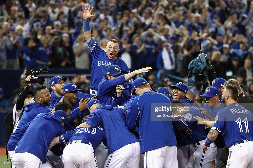 Troy Tulowitzki #2 and the Toronto Blue Jays celebrate defeating the Baltimore Orioles 5-2 to win the American League Wild Card game at Rogers Centre on October 4, 2016 in Toronto, Canada.