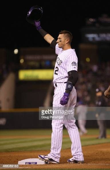 Troy Tulowitzki of the Colorado Rockies acknowledges the fans after hitting his 1000th career hit a single off of relief pitcher Daisuke Matsuzaka of...