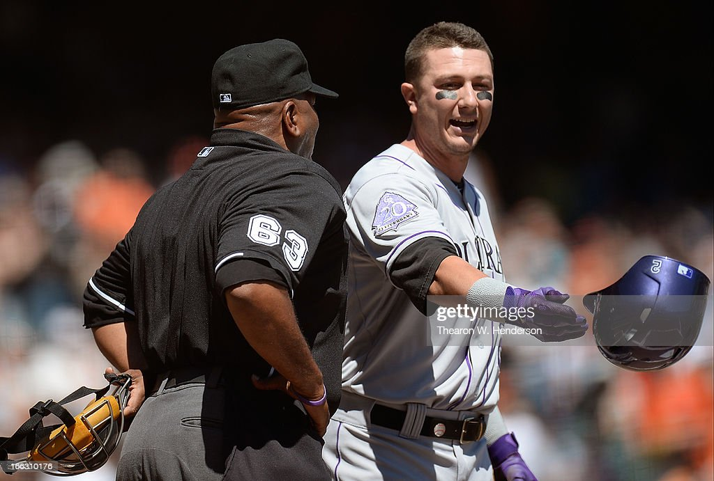 Troy Tulowitzki of the Colorado Rockies argues with home plate umpire Laz Diaz over a called strike three against the San Francisco Giants in the...