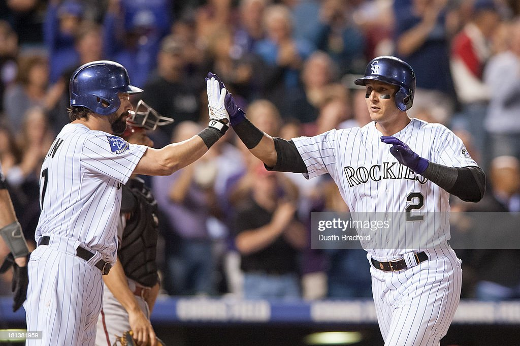 <a gi-track='captionPersonalityLinkClicked' href=/galleries/search?phrase=Troy+Tulowitzki&family=editorial&specificpeople=757353 ng-click='$event.stopPropagation()'>Troy Tulowitzki</a> #2 of the Colorado Rockies celebrates a seventh-inning home run against the Arizona Diamondbacks with teammate <a gi-track='captionPersonalityLinkClicked' href=/galleries/search?phrase=Todd+Helton&family=editorial&specificpeople=200735 ng-click='$event.stopPropagation()'>Todd Helton</a> #17 at Coors Field on September 20, 2013 in Denver, Colorado.