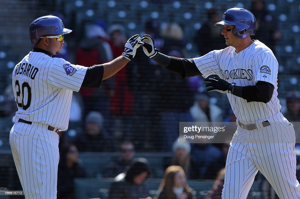 <a gi-track='captionPersonalityLinkClicked' href=/galleries/search?phrase=Troy+Tulowitzki&family=editorial&specificpeople=757353 ng-click='$event.stopPropagation()'>Troy Tulowitzki</a> #2 of the Colorado Rockies celebrates his solo homerun off of Jeremy Hefner #53 of the New York Mets with <a gi-track='captionPersonalityLinkClicked' href=/galleries/search?phrase=Wilin+Rosario&family=editorial&specificpeople=5734314 ng-click='$event.stopPropagation()'>Wilin Rosario</a> #20 of the Colorado Rockies in the eighth inning at Coors Field on April 18, 2013 in Denver, Colorado.