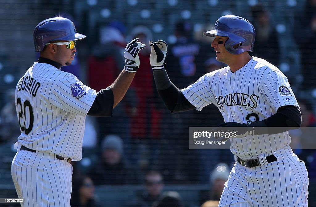 <a gi-track='captionPersonalityLinkClicked' href=/galleries/search?phrase=Troy+Tulowitzki&family=editorial&specificpeople=757353 ng-click='$event.stopPropagation()'>Troy Tulowitzki</a> #2 of the Colorado Rockies celebrates his solo homerun against the New York Mets with <a gi-track='captionPersonalityLinkClicked' href=/galleries/search?phrase=Wilin+Rosario&family=editorial&specificpeople=5734314 ng-click='$event.stopPropagation()'>Wilin Rosario</a> #20 of the Colorado Rockies at Coors Field on April 18, 2013 in Denver, Colorado. The Rockies defeated the Mets 11-3.