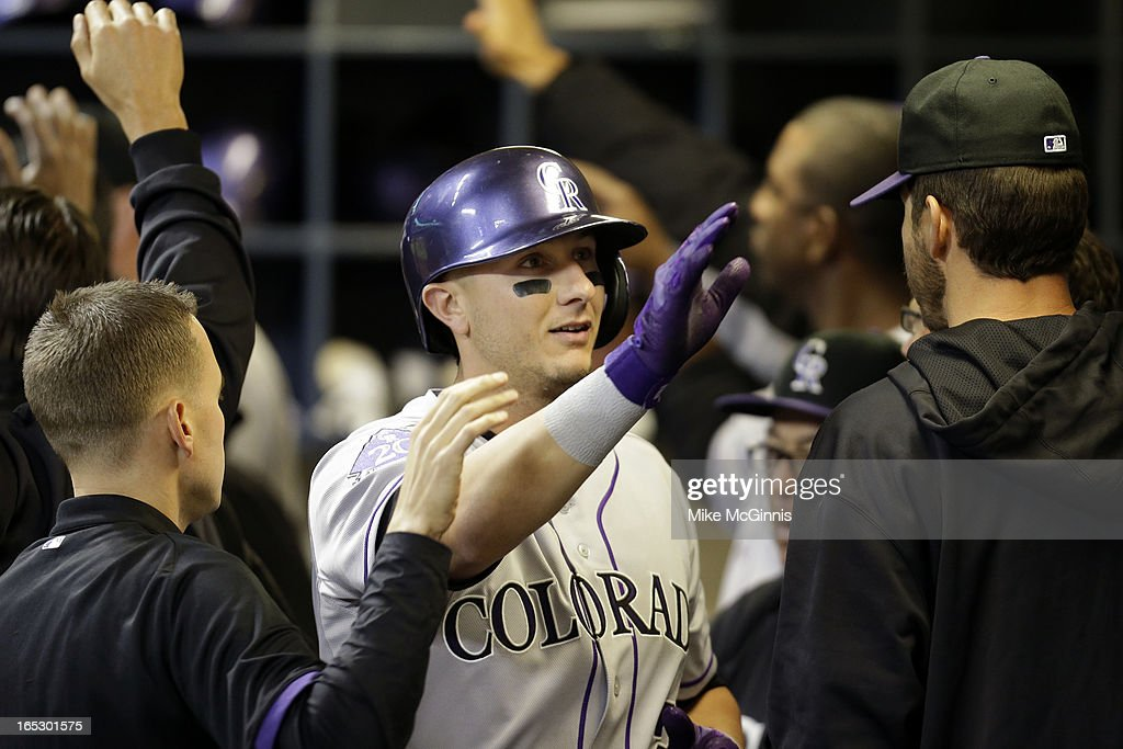 <a gi-track='captionPersonalityLinkClicked' href=/galleries/search?phrase=Troy+Tulowitzki&family=editorial&specificpeople=757353 ng-click='$event.stopPropagation()'>Troy Tulowitzki</a> #2 of the Colorado Rockies celebrates in the dugout after scoring Dexter Fowler in the top of the seventh inning on a sacrafice fly against the Milwaukee Brewers at Miller Park on April 2, 2013 in Milwaukee, Wisconsin.