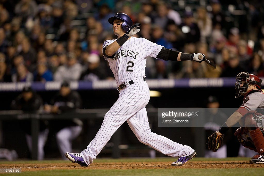 <a gi-track='captionPersonalityLinkClicked' href=/galleries/search?phrase=Troy+Tulowitzki&family=editorial&specificpeople=757353 ng-click='$event.stopPropagation()'>Troy Tulowitzki</a> #2 of the Colorado Rockies follows through on a two-run home run during the fourth inning against the Arizona Diamondbacks at Coors Field on April 19, 2013 in Denver, Colorado. The Rockies defeated the Diamondbacks 3-1.