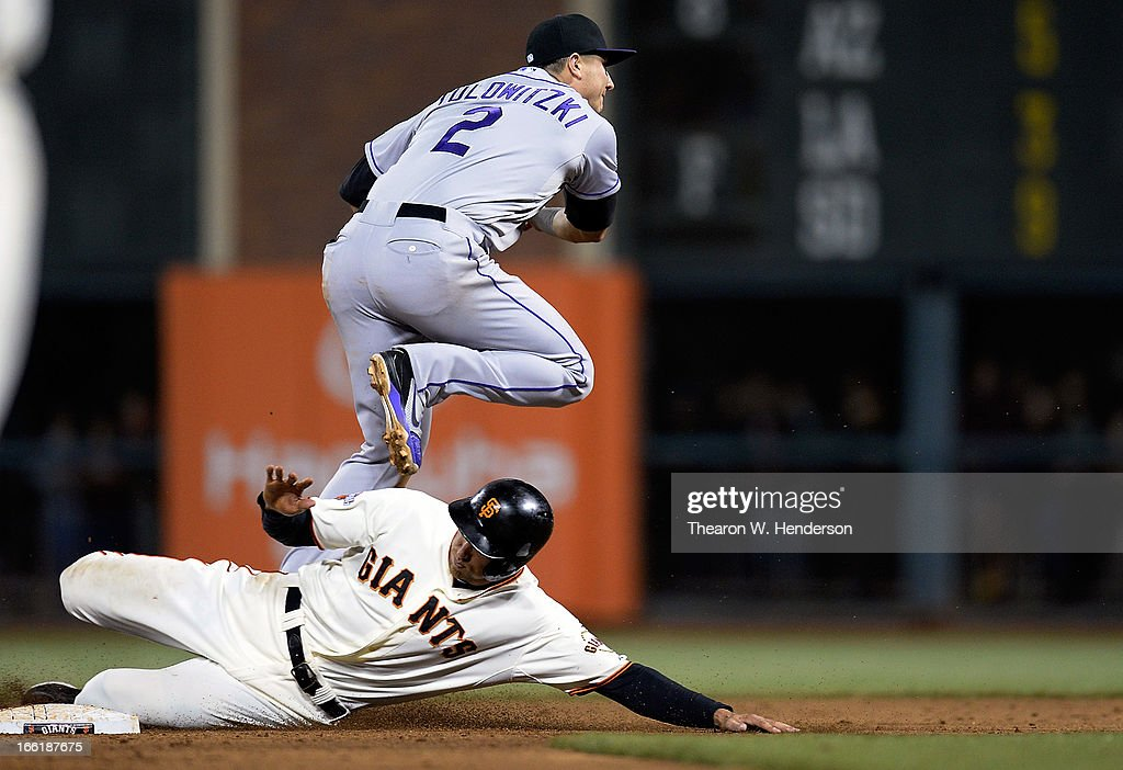 <a gi-track='captionPersonalityLinkClicked' href=/galleries/search?phrase=Troy+Tulowitzki&family=editorial&specificpeople=757353 ng-click='$event.stopPropagation()'>Troy Tulowitzki</a> #2 of the Colorado Rockies gets his throw off to first base completing the double-play, while avoiding the slide of <a gi-track='captionPersonalityLinkClicked' href=/galleries/search?phrase=Hunter+Pence&family=editorial&specificpeople=757341 ng-click='$event.stopPropagation()'>Hunter Pence</a> #8 of the San Francisco Giants in the six inning at AT&T Park on April 9, 2013 in San Francisco, California.