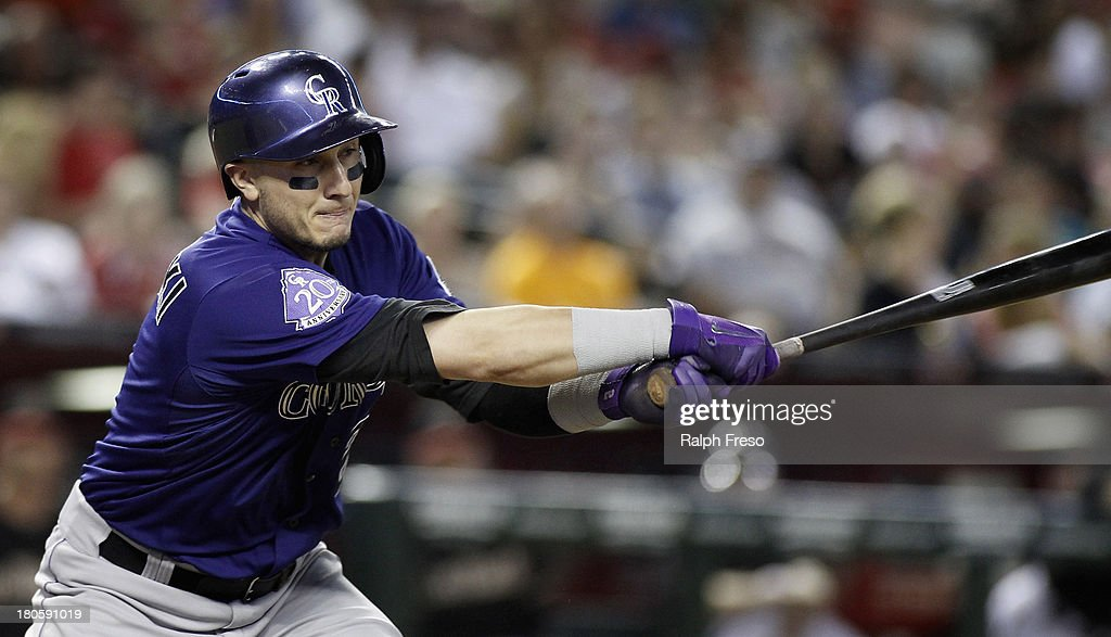 <a gi-track='captionPersonalityLinkClicked' href=/galleries/search?phrase=Troy+Tulowitzki&family=editorial&specificpeople=757353 ng-click='$event.stopPropagation()'>Troy Tulowitzki</a> #2 of the Colorado Rockies hits a ground ball to the right side of the infield against the Arizona Diamondbacks during the fifth inning of a MLB game at Chase Field on September 14, 2013 in Phoenix, Arizona.