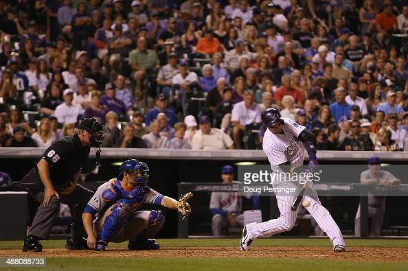 Troy Tulowitzki of the Colorado Rockies hits a single off of relief pitcher Daisuke Matsuzaka of the New York Mets for his 1000th career hit as...