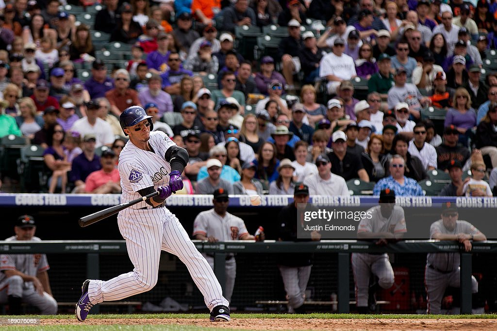 <a gi-track='captionPersonalityLinkClicked' href=/galleries/search?phrase=Troy+Tulowitzki&family=editorial&specificpeople=757353 ng-click='$event.stopPropagation()'>Troy Tulowitzki</a> #2 of the Colorado Rockies hits a two-RBI single during the sixth inning against the San Francisco Giants at Coors Field on May 19, 2013 in Denver, Colorado. The Rockies defeated the Giants 5-0.