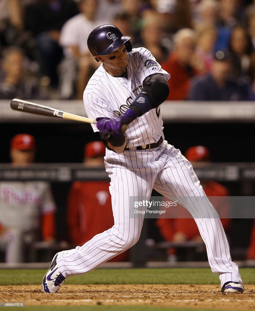 <a gi-track='captionPersonalityLinkClicked' href=/galleries/search?phrase=Troy+Tulowitzki&family=editorial&specificpeople=757353 ng-click='$event.stopPropagation()'>Troy Tulowitzki</a> #2 of the Colorado Rockies hits an RBI single off of Mario Hollands #43 of the Philadelphia Phillies to score Drew Stubbs #13 and take a 9-1 lead in the sixth inning at Coors Field on April 18, 2014 in Denver, Colorado.