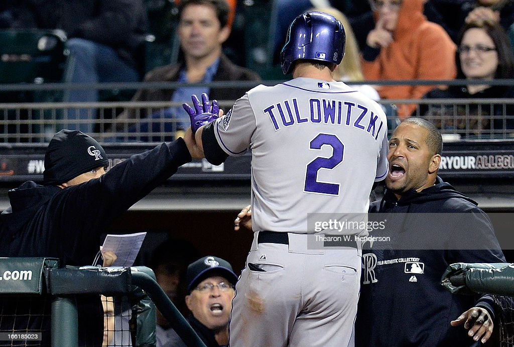 <a gi-track='captionPersonalityLinkClicked' href=/galleries/search?phrase=Troy+Tulowitzki&family=editorial&specificpeople=757353 ng-click='$event.stopPropagation()'>Troy Tulowitzki</a> #2 of the Colorado Rockies is congratulated by teammate <a gi-track='captionPersonalityLinkClicked' href=/galleries/search?phrase=Yorvit+Torrealba&family=editorial&specificpeople=212721 ng-click='$event.stopPropagation()'>Yorvit Torrealba</a> (R) and coach Dante Bichette (L) after Tulowitzki hit a solo home run against the San Francisco Giants in the fifth inning at AT&T Park on April 9, 2013 in San Francisco, California.